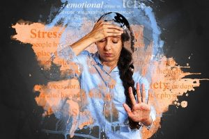 Stop feeling anxious. Woman with one hand on the forehead and the other in front of her giving indication to stop.
