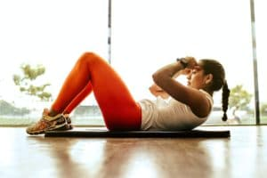 do a quiet cardio workout at home - picture of woman doing a quiet cardio workout