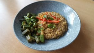 coconut dhal recipe - picture of coconut dahl curry and okra curry on a blue plate