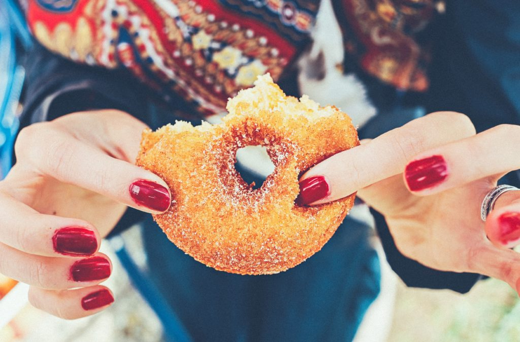 Stop emotional eating - Hands holding a ring doughnut