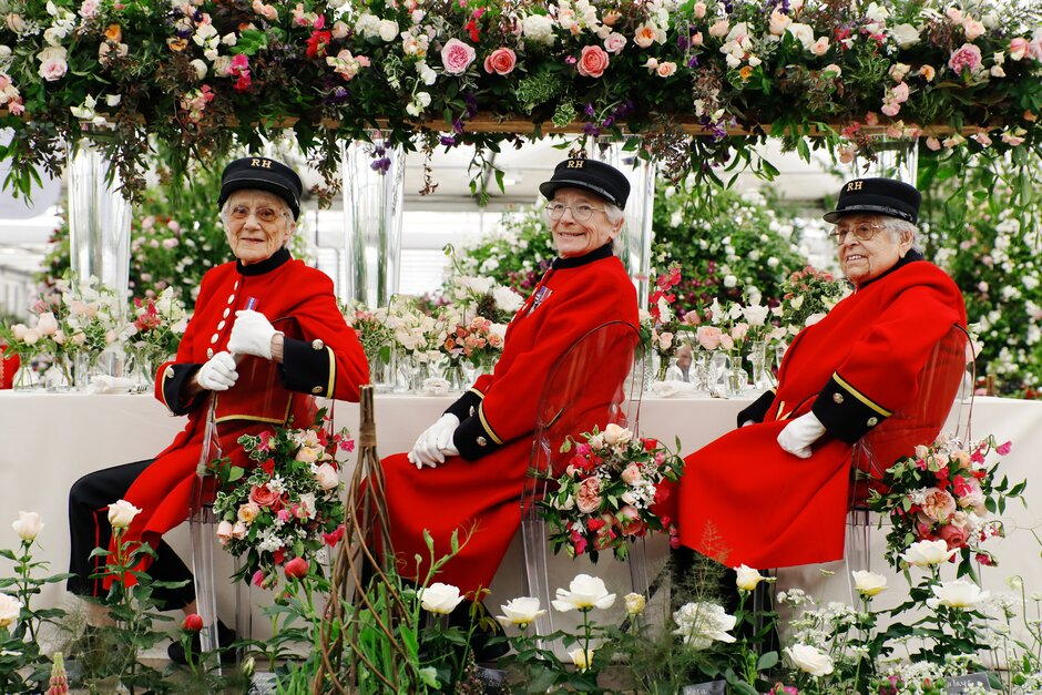 Female Chelsea Pensioners pose during Chelsea Flower Show