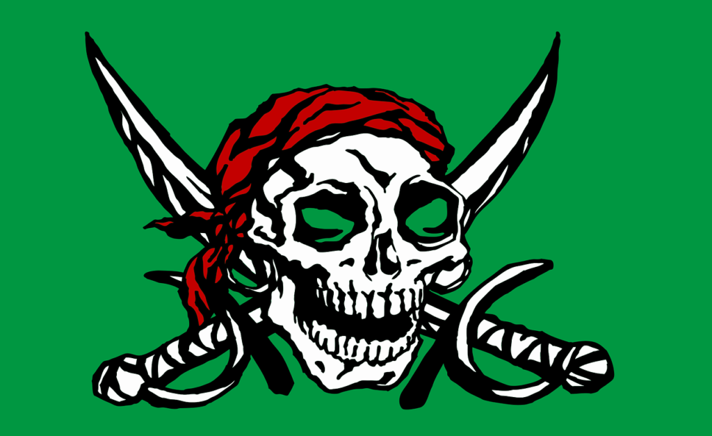 green flag with drawing of skull and cutlasses