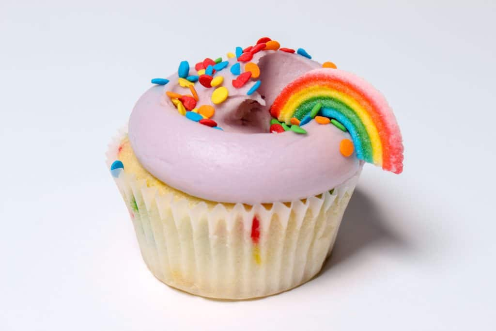 rainbow party food-Cupcake with rainbow decoration.