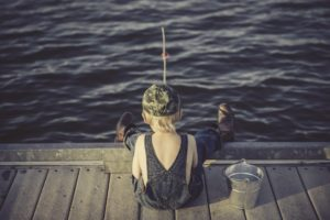 Create a kids fishing rod - image of boy fishing.