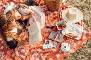 Summer Picnic Ideas for Kids - image of children having a picnic.