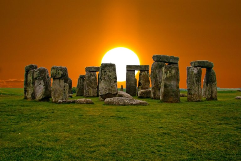 Summer Solstice history - photo of the sun rising at stonehenge.