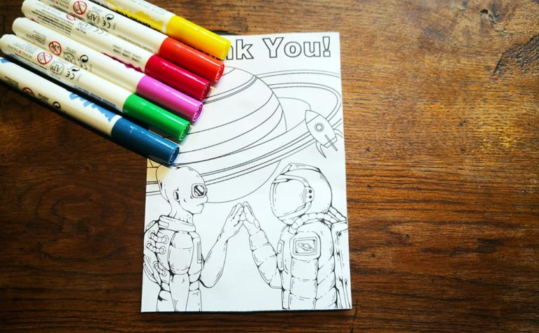 thank you cards for kids to make - image of a homemade thank you card and some coloured pens.