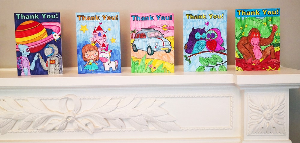 thank you cards for kids - homemade thank you cards coloured in and arranged on a mantlepiece.